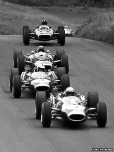 Five world champions and not a crash barrier in sight. Jack Brabham leads from Denny Hulme, Jackie Stewart, Graham Hill and Jim Clark during the 1966 F1 Gold Cup at Oulton Park