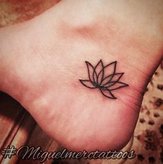 The lotus is one of my favorite tattoos and this simple one gorgeously placed on the foot is fantastic.  More From  The Stir :  16 Things Tattoos Say About the Kind of Parent You Are