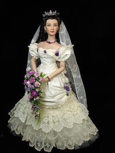 One of a Kind Scarlett with her Bouquet. The dress is in the styles of an 1870's gown.