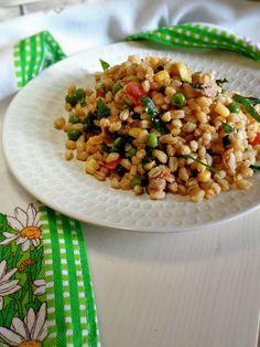 Grano con verdure, zucchine trifolate, tonno e rucola