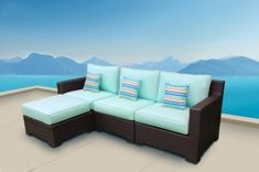The Provence Outdoor Patio Wicker Sunbrella Spectrum Mist Medium Sectional Sofa with Left Arm Chaise by Cieux features a sleek and modern style that would complement any outdoor patio or lanai. In addition to quality comfort, the Provences modular design includes a left and right arm chair, armless chair, and ottoman that can be rearranged to suit your space and vision. You can move the ottoman on either side of the sofa.