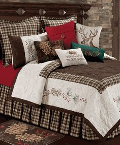 Lookout Mountain Bedding Embroidered pinecones, red berries and quilted leaf designs are combined with rustic plaid and red, green, brown and cream solids to create the outdoors-inspired 100% cotton Lookout Mountain Quilt Bedding Collection. Machine wash; Spot clean pillows and rug.
