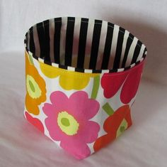 Marimekko mini Unikko fabric basket.  Add a matching pot holder and voila it is a fabulous hostess gift.  https://www.etsy.com/listing/163378117/mini-unikko-marimekko-fabric-basket?ref=shop_home_active