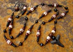 Peace River fossil shark tooth necklace with with amber, wood, and betel nut beads. SolOpsArt at Etsy.com