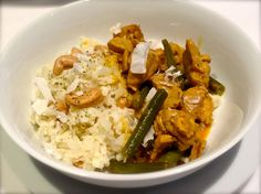 Fragrant Chicken Coconut Curry with Coconut Cashew Cauliflower Rice. It is packed with vegetables, high in fibre.
