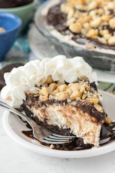 Hula Pie - this easy no bake pie has an Oreo crust, macadamia nut ice cream, and hot fudge! Everyone loves it!