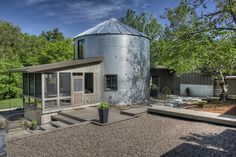 Grain silo house with chicken coop extension
