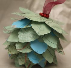 Idea:  use maps from vacations to make 'petals' for the pine one. Pinecone Map Ornament - Turtles and Tails blog