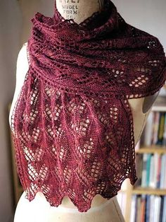 "A lovely beginning lace project.   This wide and versatile scarf is great for year-round wear, featuring a shimmery moth motif with scalloped hem. Knit with approximately 550 yds of lace-weight yarn at a gauge of 24 sts and 32 rows per 4"" using U.S. size 4/3.5mm needles. Finished size is 14"" x 64"" after stretching and blocking."