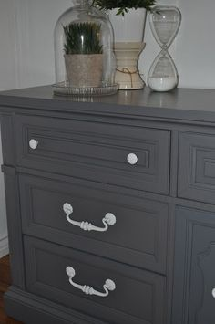 Love the white hardware on this gray dresser..for buffet in playroom?