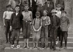 """Photos taken during noon hour, October 23rd, 1912, at the Loray Mills, Gastonia, N.C. They said they were working and went in to work. At night I counted over thirty children coming out when the whistle blew, and they seemed to be from ten to twelve years old. The Superintendent was much disturbed over the photos."" Photograph and caption by Lewis Wickes Hine"