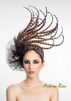 this is a new headpiece from my 2013 Collection... meet COCO  this headpiece is made on a 4 wide headband, covered with small pheasant feathers.