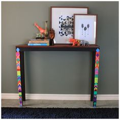 Chalkboard paint and a clever design enhanced this entry table (via Elements At Home)