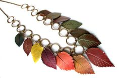 Hey, I found this really awesome Etsy listing at http://www.etsy.com/listing/88432755/polymer-clay-necklace-fall-leaves
