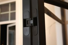 Painted black mat, metal doors with clear glass and hidden hinges. its simplicity perfectly fit to almost every interior. Realization by Zbigniew Bakanowicz Oslo - Norway Hidden Hinges, Metal Doors, Oslo, Clear Glass, Norway, Door Handles, Studio, Fit, Interior