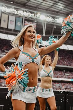 Team Spotlight: Miami Dolphins Cheerleader's New Uniforms Miami Cheerleaders, Dolphins Cheerleaders, Cheerleading Uniforms, Cheer Uniforms, College Cheerleading, Cute Cheer Pictures, Dance Team Pictures, Professional Cheerleaders, Girls In Mini Skirts