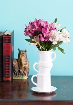 Beautiful Balance Vase. Youve been fortunate enough to find the time to cultivate both a growing career and a flourishing garden, so delight in the result of your handiwork by refreshing your desk decor with this charming, quirky vase! #white #wedding #modcloth
