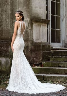 Christine by #JustinAlexander - Wrap yourself in luxury on your wedding day by slipping into this stretch Jersey lined #weddingdress with new power stretch mesh to define your shape. Sheer V-neckline straps create a modern illusion V-back. Rich lace covers the gown with subtle accents of beading. Nude/Ivory, Ivory