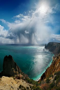 Raining over the sea.