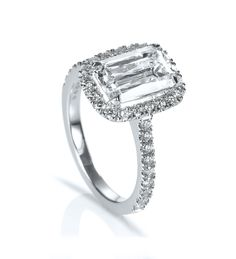 Vintage Ashoka-Cut Diamond Ring. Ashoka and round-brilliant cut diamonds in platinum