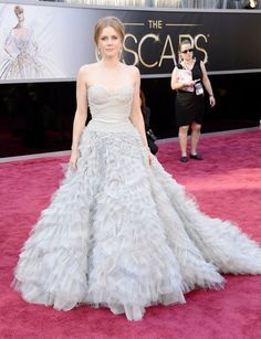 Amy Adams brings me back to Enchanted, in a good way. The work on the bodice is lovely, and the simple hair, make up, and jewelry compliment this ruffle extravaganza - Oscars 2013