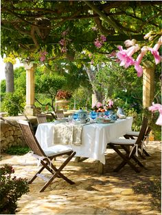Outdoor dining room under pergola.
