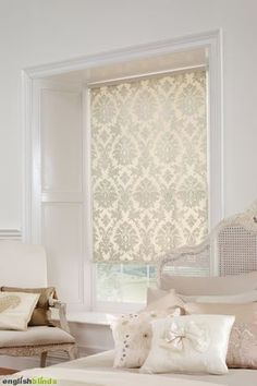Luxury cream damask blinds in a white bedroom with a shabby chic bed