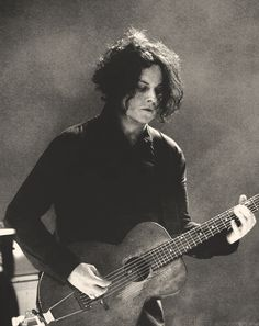 Jack White- long natural tousled hair.