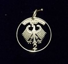 Dots 1990 2 dollar coin and hand  out to make a beautiful pendant with an eagle design silver, and can be found for sale at:  https://www.etsy.com/au/shop/ChronicSmithing?ref=search_shop_redirect