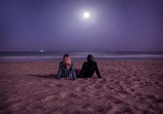 Sitting on the beach at night stargazing and enjoying the full moon light.