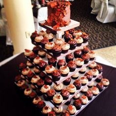 Fall Wedding Cupcake Tower - Apple Pie and Double Chocolate cupcakes adorned with handmade fondant leaves in burnt orange and brown. Tip - make fondant leaves well ahead of time, to all them to set. They'll absorb moisture from the frosting once places on top of cupcakes - so ensure they're fully firmed up before decorating with them!