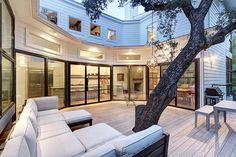 Bouldin Creek Residence centered around an oak tree in Texas