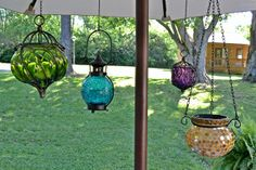 I love these hanging lanterns from Pier 1.  LED tea lights are in them too.  How brilliant.