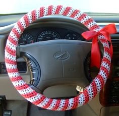 Crochet Candy Cane Steering Wheel Cover. Show your holiday spirit even while you're driving down the street. Use this free crochet pattern and make a candy cane steering wheel cover. It'll make your hands warm while driving too. Two different styles.  One for my car and one for my golf cart.  ¯\_(ツ)_/¯