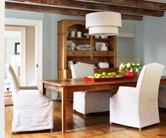 A new hutch made from salvaged pine, and a table built by homeowner, are right at home in this farmhouse dining room with its centuries-old floorboards and hand-hewn beams. Mitch Lillian. | Photo: Tria Giovan | thisoldhouse.com