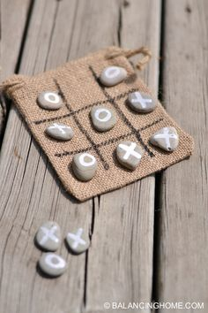 Make an easy travel Tic-Tac-Toe game using rocks, Painter paint markers, and a burlap bag. The bag can hold the rocks and also act as the game board so this DIY craft is perfect for travel and vacations.
