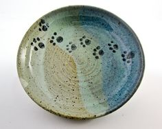 A sturdy stoneware ceramic pottery clay feeding dish or shallow bowl for your pet small dog or cat. Handmade with a speckled light colored