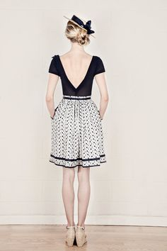 Love this outfit from the back view! However ; After seeing the front of the shirt...i'd much rather just have the skirt.