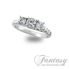 Give her the ring of her dreams with our Fantasy engagement ring! This ring is a classical three stone ring, with crossing prongs on the side and micro pave diamond simulant accents on the shank. From now until the end of June this ring is only $559.20 plus FREE shipping! To order our Fantasy ring call 1-800-682-0581 or visit http://www.lab-diamonds.com/fantasy-lab-created-engagement-ring.html