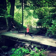 Day fourteen! #YogaADay warrior I pose on a bridge hiking in Forest Park #PDX