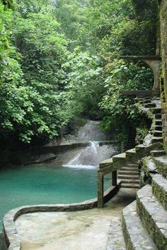 """voiceofnature: Amazingly surreal Las Pozas in the rainforest by Xilitla in the Mexico mountains. Created by Edward James in the 40′s, it includes more than 80 acres of natural waterfalls and pools interlaced with towering surrealist sculptures and buildings. The many trails throughout the garden site are composed of steps, ramps, bridges and narrow, winding walkways that traverse the valley walls. It was supposed to be a """"Garden of Eden"""" containing a huge variety of plants and animals."""