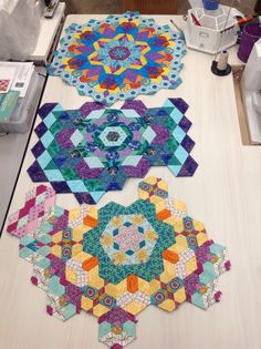 The New Hexagon - Millefiore EPP quilt. First 3 Rosettes done