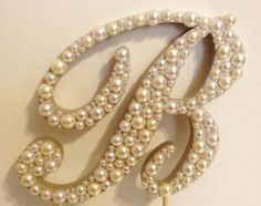 Script Pearl Monogram Cake Topper with Pearlescent Base and White or Ivory Pearls on Etsy, $38.50