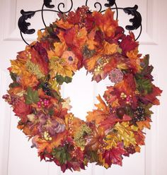 """This is a handmade wreath packed full of glorious fall colors in maple and oak leaf clusters, acorns, pine cones, pumpkins and berries. It will add warmth, life and color wherever it is hung; inside or out for many years to come. A beautiful addition to your seasonal decor. Its dimensions are: 19"""" DIA and 5"""" deep This is the item you will receive. It is READY TO SHIP. No stock photos are used. Carefully packaged and shipped in a sturdy box that can be used for storage in the off season. *..."""