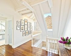 love this dreamy and airy space, and such a fabulous photo display!