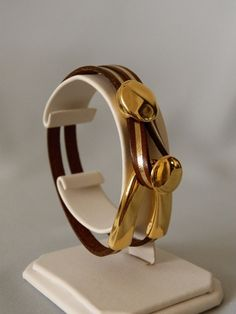 Brown and Gold Leather Bracelet http://sisters-cc-zj.com/
