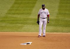 CrowdCam Hot Shot: Boston Red Sox first baseman David Ortiz watches as a paper airplane flies onto the field during the seventh inning of game five of the MLB baseball World Series against the St. Louis Cardinals at Busch Stadium. Photo by Rob Grabowski