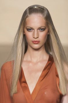 Bare Buff: Put away your curling iron, pin-straight hair is back and better than ever, as seen here on the Donna Karan Spring 2014 runway.