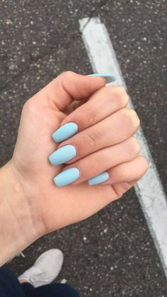 "If you're unfamiliar with nail trends and you hear the words ""coffin nails,"" what comes to mind? It's not nails with coffins drawn on them. It's long nails with a square tip, and the look has. Blue Acrylic Nails, Coffin Nails Matte, Summer Acrylic Nails, Pastel Nails, Acrylic Nail Designs, Nail Art Blue, Blue Matte Nails, Coffen Nails, Light Colored Nails"