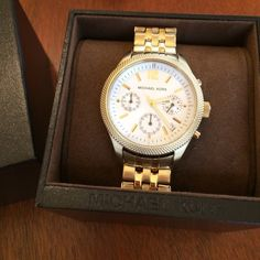 Authentic Michael Kors Jet Set Gold Watch Excellent condition-no flaws! Original box and tag and bag come with watch.  Links are removable to obtain a perfect fit! Michael Kors Accessories Watches